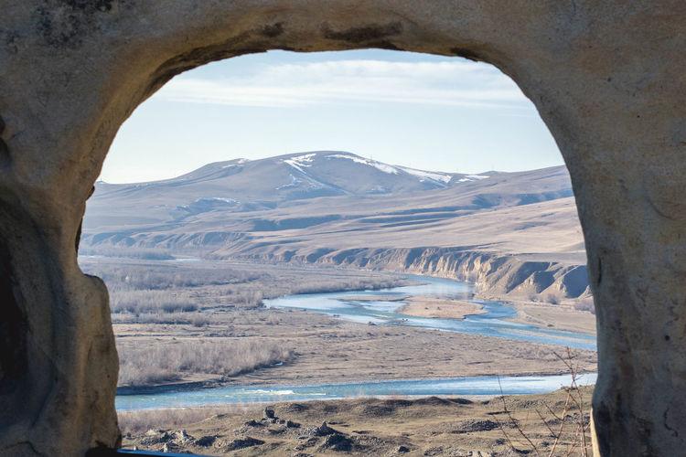 Landscape seen through arch