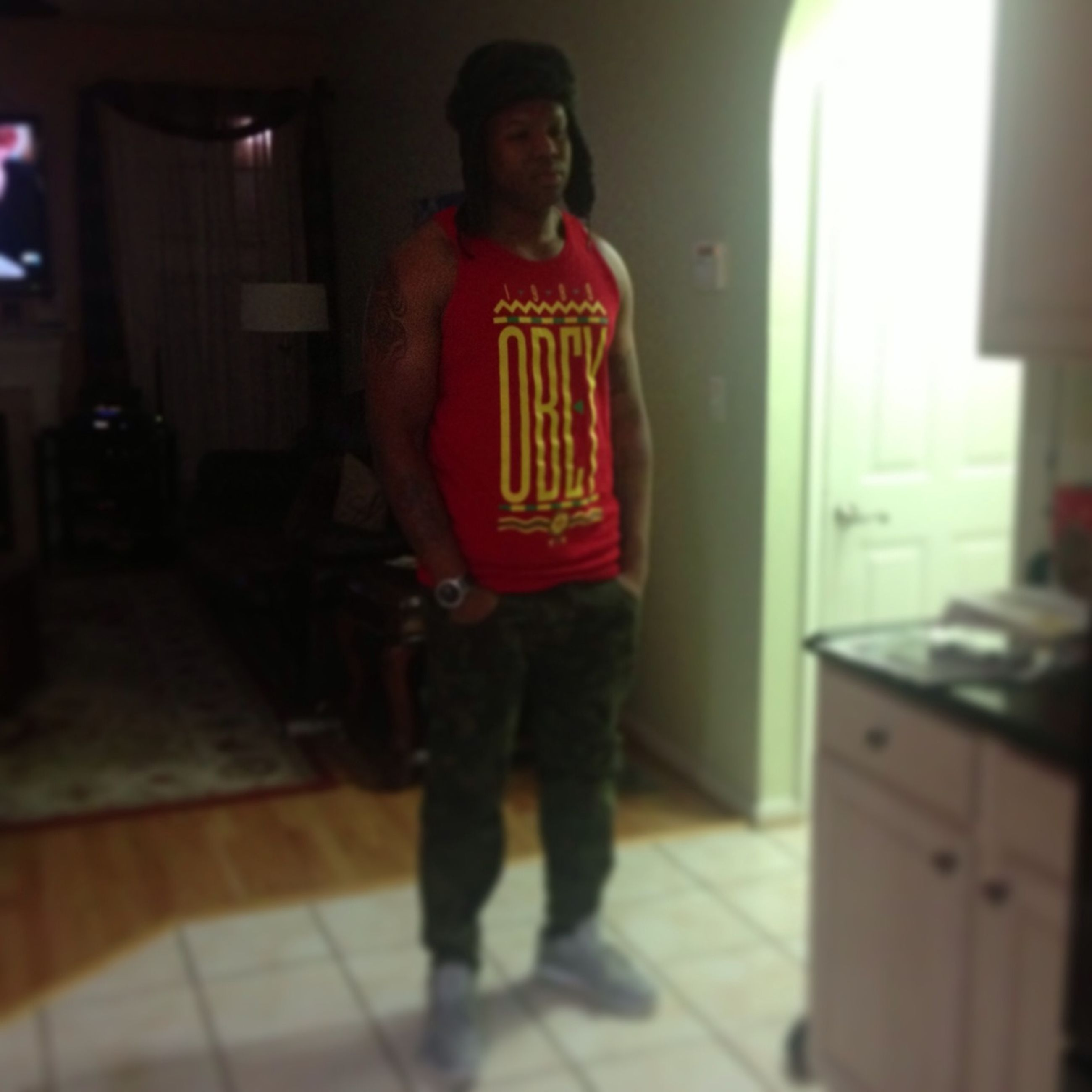 lifestyles, indoors, casual clothing, leisure activity, person, front view, young adult, looking at camera, full length, standing, portrait, three quarter length, young men, illuminated, home interior, night, holding