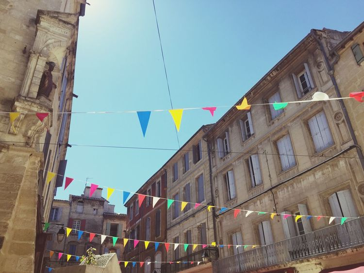 Architecture Flags Multi Colored Outdoors Blue Sky Low Angle View France Building Exterior Town
