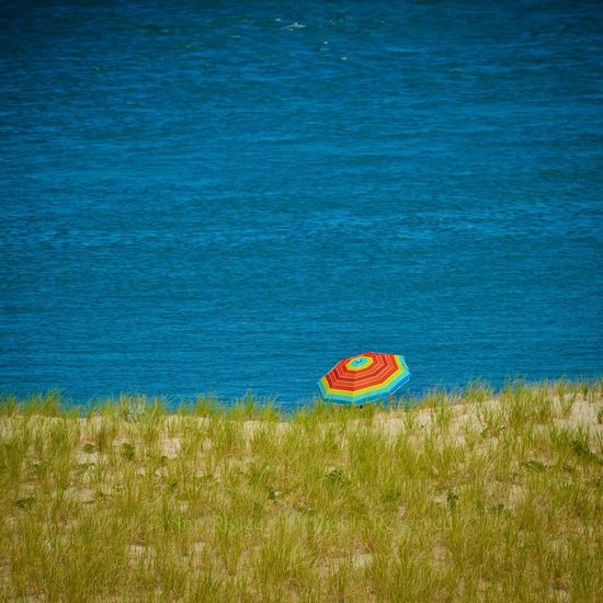 """©Ann Norsworthy Rigley. """"Wish You Were Here"""" Beach Photography Beach Umbrella Chatham Lighthouse Beach, Cape Cod Vacations IoLIGHTstudios"""