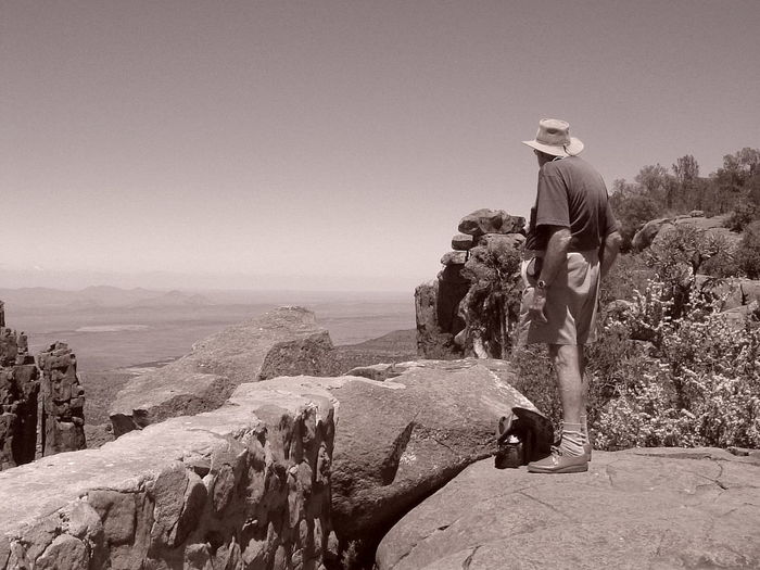 Full length of man standing on rock at cederberg against clear sky