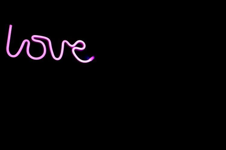 Love is everywhere.. Neon Black Background Illuminated Purple Copy Space Close-up Neon Colored Fluorescent Energy Efficient Lightbulb Commercial Sign Billboard Light Painting Single Word Glowing Written Darkroom Western Script Advertisement Fluorescent Light Information