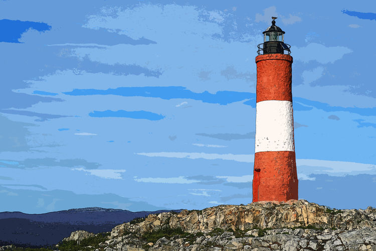 Lighthouse by building against sky