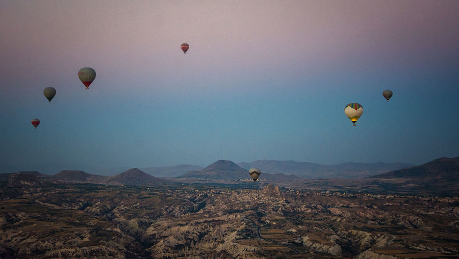 Cappadocia Adventure Ballooning Festival Beauty In Nature Clear Sky Day Flying Hot Air Balloon Landscape Mid-air Mountain Nature No People Outdoors Parachute Paragliding Scenics Sky