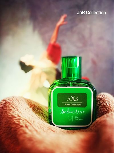 Selective Focus Indoors  Green Color Perfume Collection Scented Perfumebottle Perspective Photography Objects Of InterestEpic Object Focus Sunset_collection Vibrant Color Philippines <3 LeicaM9 Photos Around You P9 Cebu,Philippine Personal Perspective Photography Close-up Epi