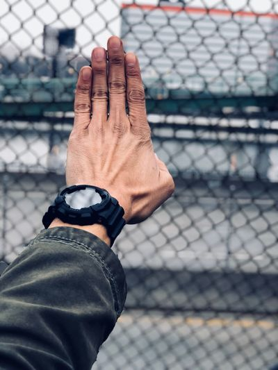 Pause Human Body Part Human Hand Hand One Person Body Part Focus On Foreground Inner Power Day Fence Chainlink Fence Real People Lifestyles Men Outdoors Leisure Activity Close-up Human Finger Human Limb Finger Limb Human Arm
