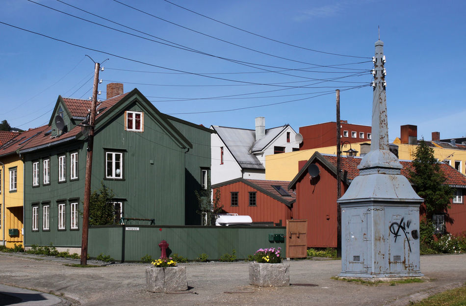 Square with colorful wooden historic houses and old transformer in Tromso, Norway Antiquated Technology Architecture Building Building Exterior Built Structure Cable Current Electricity  Electricity Pylon Graffiti Green Color Historic House Monument Old Town Outdoors Place Power Sights Sightseeing Square Transformer Utility Pole Wire Wooden