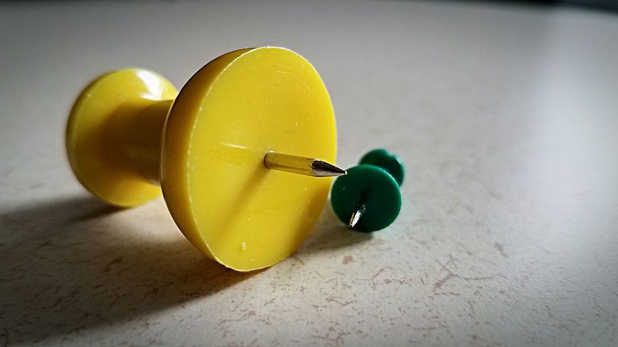 yellow and green thumbtacks Paint The Town Yellow Yellow Close-up Sharp Tack Push Pins Green Office Supply