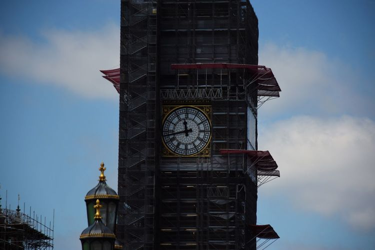 Low angle view of big ben tower against sky