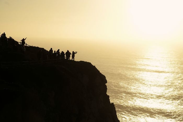 Silhouette End Of Europe Rocks People Photography Abyss Ocean View Travel Destinations Danger Mobile Conversations Taking Photos Enjoying Life Low Angle View FUJIFILM X-T10
