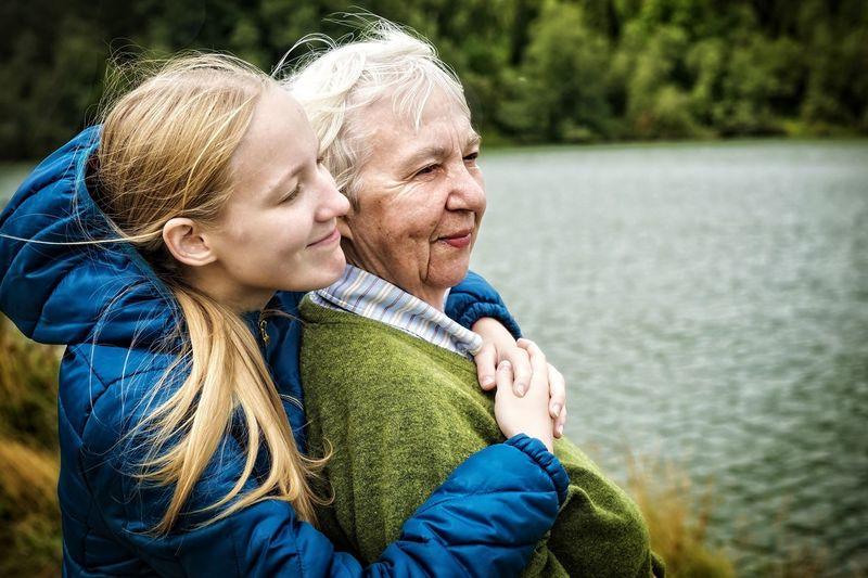 Close-up of woman embracing grandmother