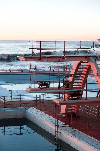 Cape Town Diving Nikon South Africa Sunset Silhouettes Sunset_collection Architecture Beauty In Nature Building Exterior Clear Sky Diving Board No People Outdoors Pool Sea Sky Sunset Swimming Pool Water