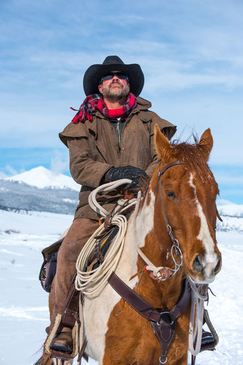 Feb 2019 - Music Mountain Ranch Colorado Cowboy Cowboy Hat Lassoing Rope Chaps Working Animal Warm Clothing Outdoors Snow One Person Cold Temperature Sky Day Riding Winter Animal Themes Livestock Horse Domestic Animals Mammal Animal One Animal Herbivorous Activity Vertebrate Domestic