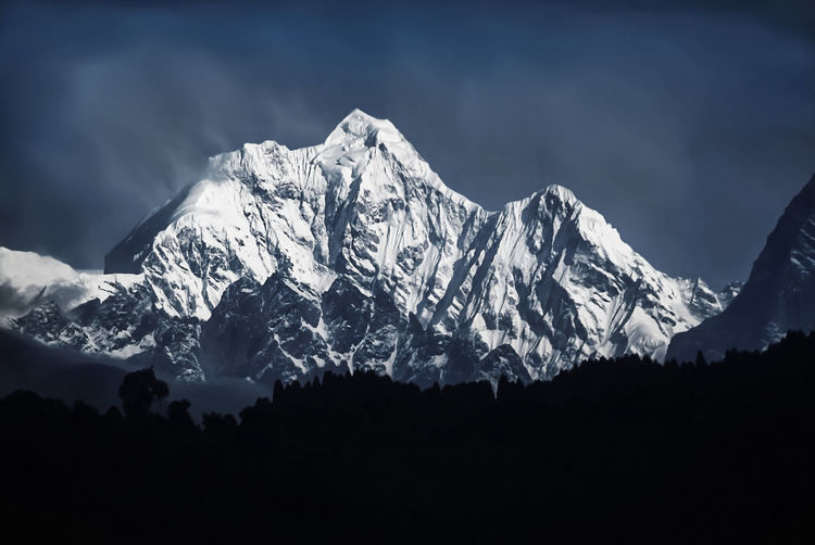 Kangchenjunga (8,586 m. or 28,169 ft.) the third highest mountain in the world, scene from Gangtok, Sikkim. Mountain Beauty In Nature Mountain Range Scenics - Nature Sky Nature Mountain Peak Environment Cold Temperature Snowcapped Mountain Snow Tranquil Scene Winter Cloud - Sky Tranquility No People Landscape Non-urban Scene Physical Geography Outdoors Kangchenjunga Sikkim Himalayas Attractions Dawn