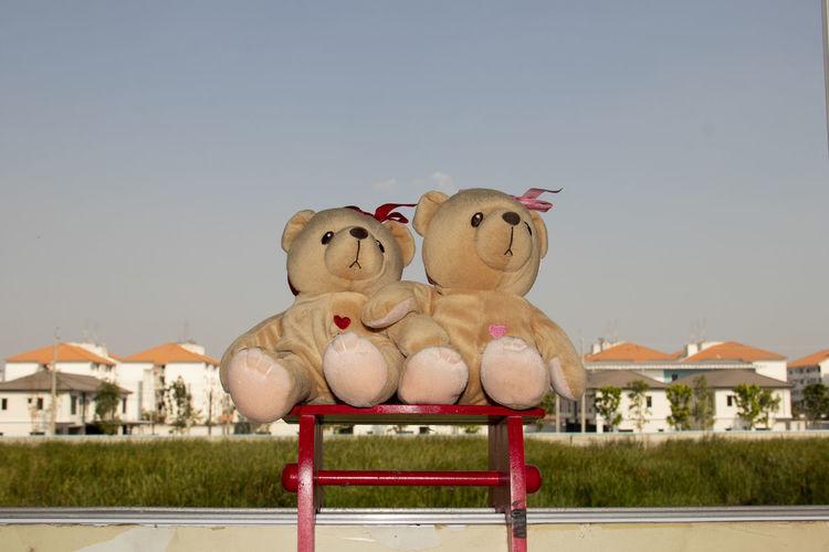 Stuffed toy against sky