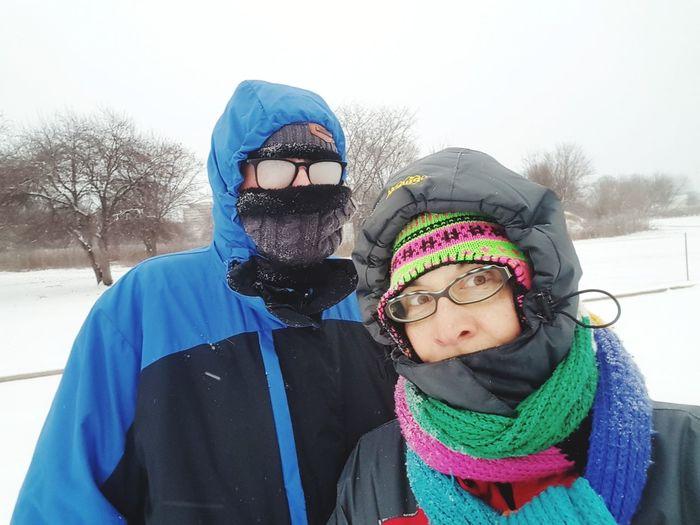 Portrait Of People Wearing Warm Clothing In Winter