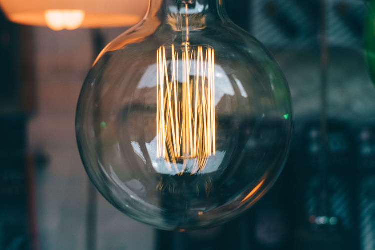 Close-up Crystal Ball Electric Light Electricity  Extreme Close-up Filament Focus On Foreground Geometric Shape Glass - Material Ideas Illuminated Lens Flare Light Bulb Lighting Equipment Reflection Transparent #HolidayMarketing