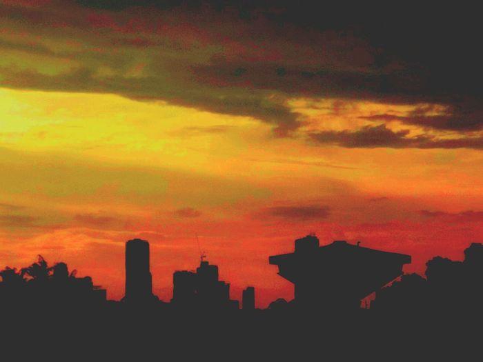 Vermillion Hues Cityscape Sunset City Silhouette Urban Skyline Building Exterior Sky Architecture Dramatic Sky Built Structure Skyscraper Cloud - Sky Outdoors Romantic Sky No People Scenics Abstarct Clouds Collection Vermillion Sun Bleeding Sky