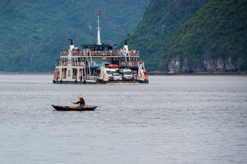 Halong Bay Vietnam Day Incidental People Mode Of Transportation Motion Nature Nautical Vessel on the move Outdoors Passenger Craft People Real People Sailboat Sailing Sea Ship Transportation Travel Tree Water Waterfront