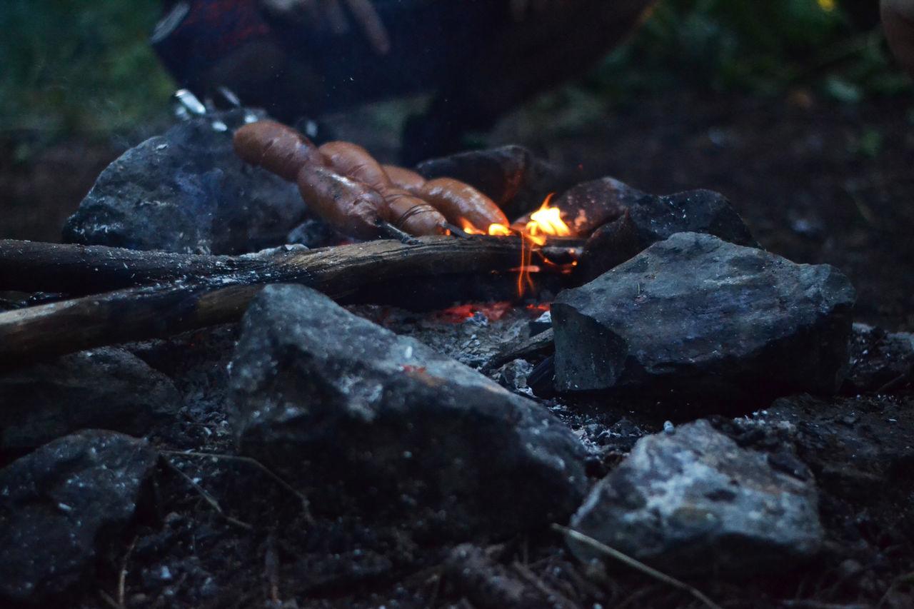 Close-up of sausage on campfire