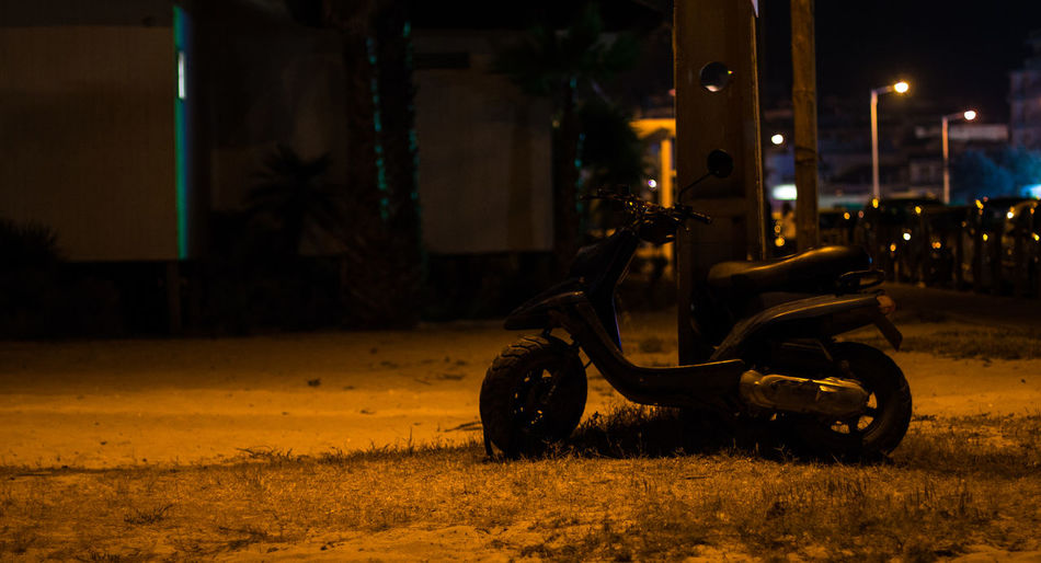 Motor Scooter On Field At Night