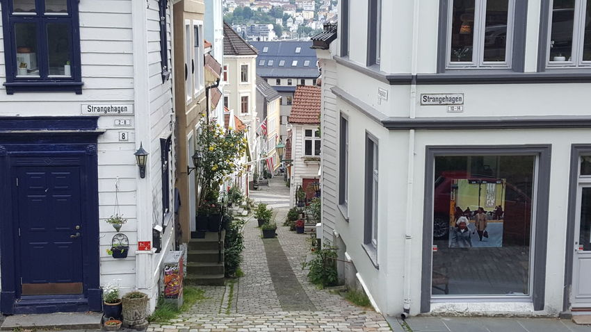 "Bergen (Norwegian pronunciation: [ˈbærɡən] ( listen), historically Bjørgvin, is a city and municipality in Hordaland on the west coast of Norway. At the end of the first quarter of 2016, the municipality's population was 278,121, and the urban population was 250,420 as of 1 January 2015, making Bergen the second-largest city in Norway. The municipality covers an area of 465 square kilometres (180 sq mi) and is located on the peninsula of Bergenshalvøyen. The city centre and northern neighbourhoods are located on Byfjorden, ""the city fjord"", and the city is surrounded by mountains; Bergen is known as the city of seven mountains. Many of the extra-municipal suburbs are located on islands. Bergen is the administrative centre of Hordaland and consists of eight boroughs—Arna, Bergenhus, Fana, Fyllingsdalen, Laksevåg, Ytrebygda, Årstad and Åsane. Trading in Bergen may have started as early as the 1020s. According to tradition, the city was founded in 1070 by king Olav Kyrre; its name was Bjørgvin, ""the green meadow among the mountains"". It served as Norway's capital in the 13th century, and from the end of the 13th century became a bureau city of the Hanseatic League. Until 1789, Bergen enjoyed exclusive rights to mediate trade between Northern Norway and abroad and it was the largest city in Norway until the 1830s when it was surpassed by the capital, Oslo. What remains of the quays, Bryggen, is a World Heritage Site. The city was hit by numerous fires over the years. The ""Bergen School of Meteorology"" was developed at the Geophysical Institute beginning in 1917, the Norwegian School of Economics was founded in 1936, and the University of Bergen in 1946. From 1831 to 1972, Bergen was its own county. In 1972 the municipality absorbed four surrounding municipalities, and at the same time became a part of Hordaland county. The city is an international centre for aquaculture, shipping, offshore petroleum industry and subsea technology, and a national centre for higher education, media, tourism and finance. Bergen Port is Norway's busiest in both freight and passengers with over 300 cruise ship calls a year bringing nearly a half a million passengers to Bergen, a number that has doubled in ten years. Almost half of the passengers are German or British. The city's main football team is SK Brann and the city's unique tradition is the buekorps. Natives speak the distinct Bergensk dialect. The city features Bergen Airport, Flesland, Bergen Light Rail, and is the terminus of the Bergen Line. Four large bridges connect Bergen to its suburban municipalities. Bergen is well known for having the mildest winter climate, though with a lot of precipitation, of all cities in the Nordic countries. In December - March, the temperature difference between Bergen and Oslo can be up to 30 degrees Celsius, despite the fact that both cities are located at approximately 60 degrees North. The Gulf Stream keeps the sea relatively warm, considering the latitude, and the mountains protect the city from cold winds from the north, north-east and east. Architectural Detail Architectural Feature Architecture Architecture_bw Architecture_collection Architecturelovers Architecturephotography Architectureporn EyeEm Best Shots From My Point Of View Getting Inspired Hidden Gems  Home House Houses Outdoors Romantic Scandinavia Scandinavian The Purist (no Edit, No Filter) Wood Wood - Material Wooden Wooden Building Wooden House"
