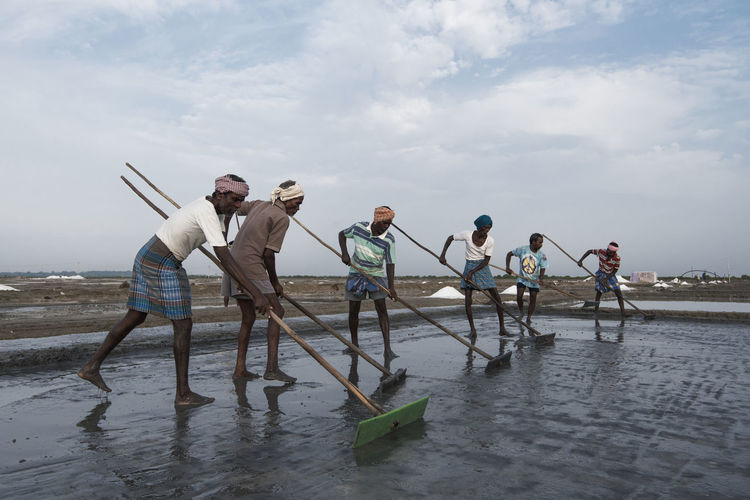Workers at Salt Pan. Stick Working Men Daily Life Daily Work Chennai Marakkanam Outdoor Salt Production Hardlife People Reflection Water Workers Salt Water Salt Pan Pan Showcase June