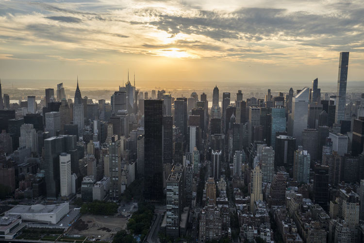 New York City Sunset by Helicopter Above Aerial Photography Aerial View Architecture Built Structure City Cityscape Cityscape Cityscapes Cloud Helicopter New York Scenics Sky Skyscraper Sun Sunset Travel Destinations Urban Urban Skyline