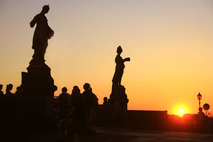 Capture Tomorrow Sunset Sky Silhouette Statue Orange Color Sculpture Men Real People Group Of People Art And Craft Human Representation Architecture Representation Large Group Of People Lifestyles Clear Sky Nature Women History Leisure Activity Outdoors