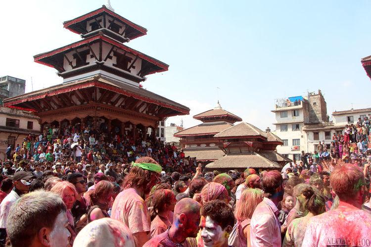 People Celebrating Holi At Durbar Square Against Sky