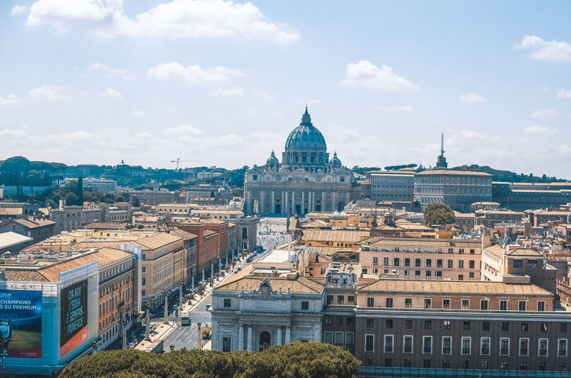 St peter basilica amidst buildings city