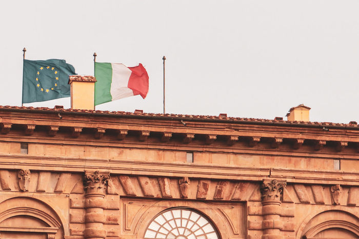 EU and ITALY EyeEm Selects City Flag History King - Royal Person Patriotism Politics And Government Architecture Sky Building Exterior Built Structure Archway The Past Historic Ancient Civilization Ancient Rome Ancient Archaeology Civilization City Gate Arch Insignia Historic Building Gate