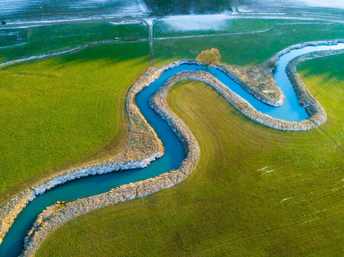 Wonderful river aerial photo Aerial View River Stream Wormed Meadow Country Nature Sunlight Spring Water High Angle View Green Color Grassland Field