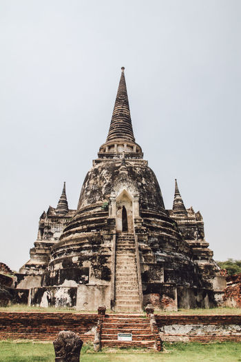 ON 26 May 2019,The old famous temple in Thailand world heritage / Wat Phrasrisanphet Architecture Built Structure Religion Belief Sky Building Exterior History The Past Place Of Worship Clear Sky Spirituality Travel Destinations Building Nature Day No People Ancient Civilization Outdoors Spire  Archaeology Tourism Statue Old ASIA Pagoda Travel Temple Culture Ayutthaya Architecture Thailand Buddha Traditional Historic Buddhism Ancient Asian  Buddhist Landmark Brick Unesco Temples Historical Heritage Tourist Destination Ruins Religious  Bright Sculpture