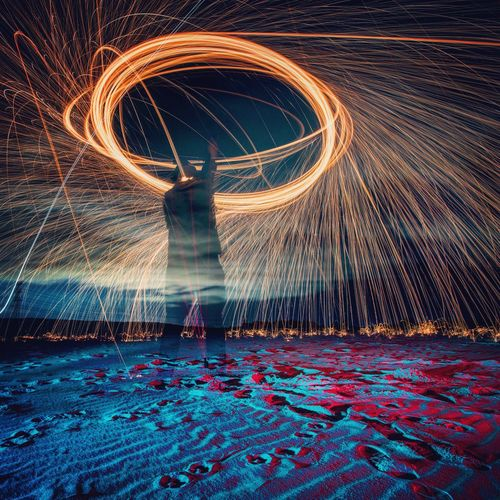Pain in the Neck Played with Fire and got burned... oh well. No pain no gain... Photo taken at the Sydney LightPainting Meetup last Saturday Motion Long Exposure Illuminated Glowing Light Trail Speed Blurred Motion Night Architecture No People Water Art And Craft Light - Natural Phenomenon Pattern Built Structure Creativity Nature City Outdoors Wire Wool