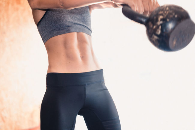 Exercising Indoor Activities Musculation  Squat Abdomen Blonde Exercising Close-up Cross Training Crossfit Crossfit Girl Energy Exercising Healthy Lifestyle Kettlebell  Leisure Activity Lifestyles Muscular Build One Person Real People Sport Sport Clothing Stretching Training Weightlifting Workout