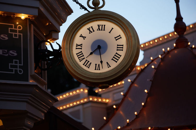 Time Clock Low Angle View Illuminated No People Architecture Built Structure Communication Number Minute Hand Clock Face Building Exterior Circle Geometric Shape Instrument Of Time Text Shape Focus On Foreground Building Roman