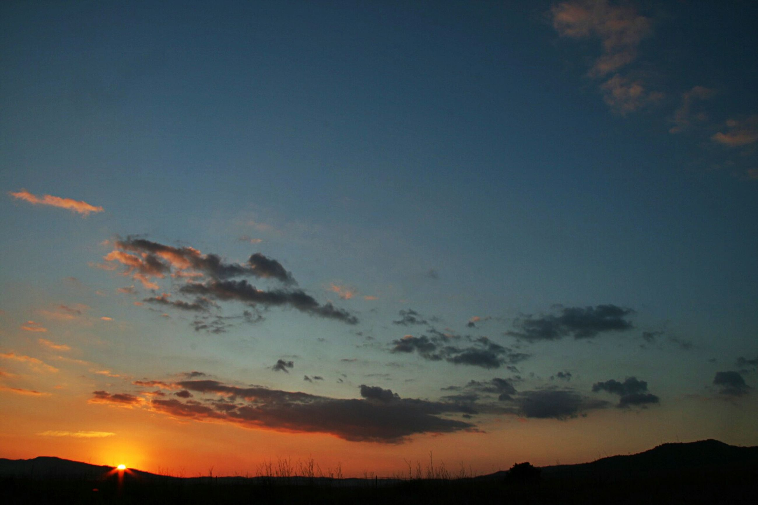 sunset, silhouette, scenics, tranquil scene, tranquility, beauty in nature, sky, mountain, landscape, orange color, sun, nature, idyllic, cloud - sky, mountain range, sunlight, outdoors, cloud, majestic, dusk
