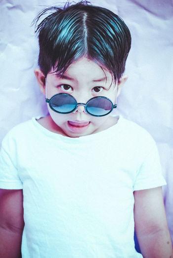 Close-portrait of cute boy with sunglasses