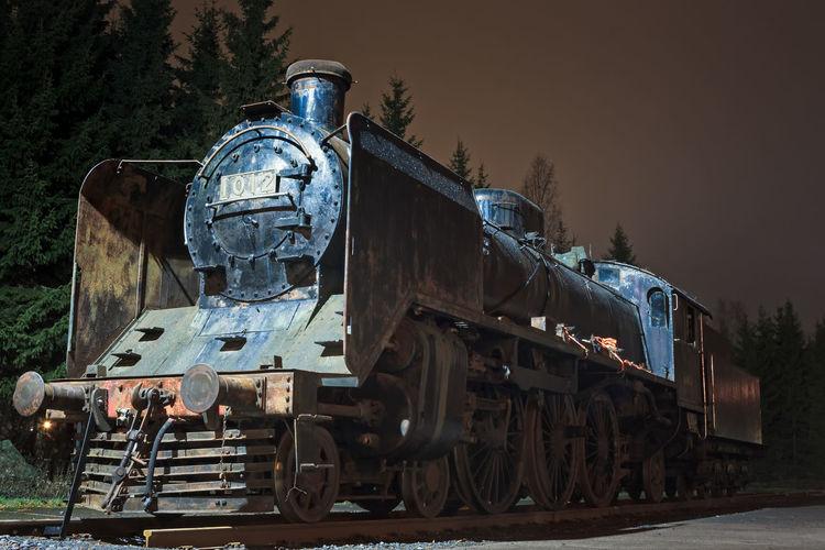 Abandoned train on railroad track at dusk