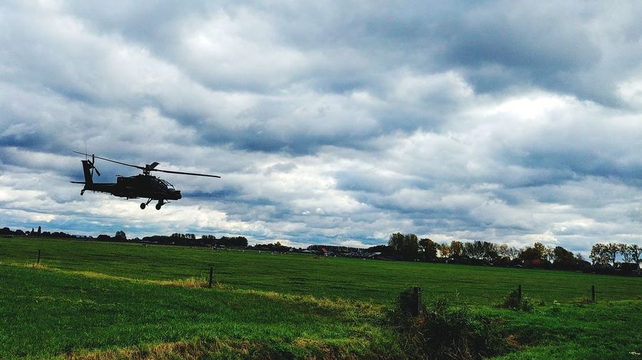 Apache Helicopter Storm Cloud Military Flying Cloud - Sky Cloud - Sky Flying Military Transportation Air Vehicle Airplane Thunderstorm Fighter Plane Airshow Storm Cloud Storm Horizontal Outdoors Sky Military Airplane Grass No People Air Force Nature Day