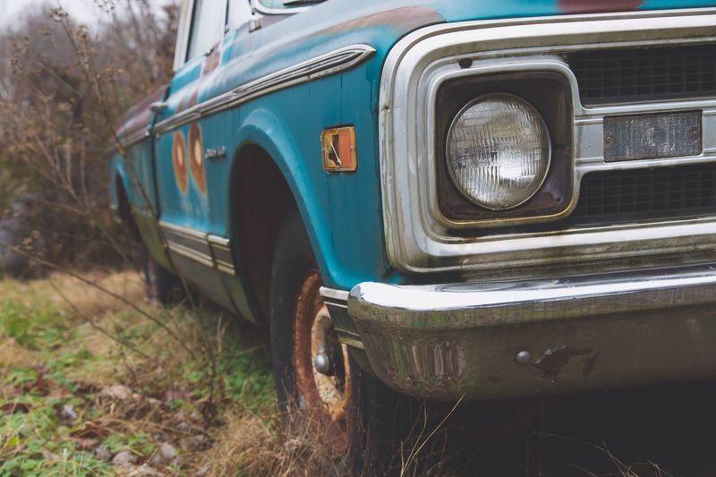 Close-Up Of Headlight Of Rusty Car