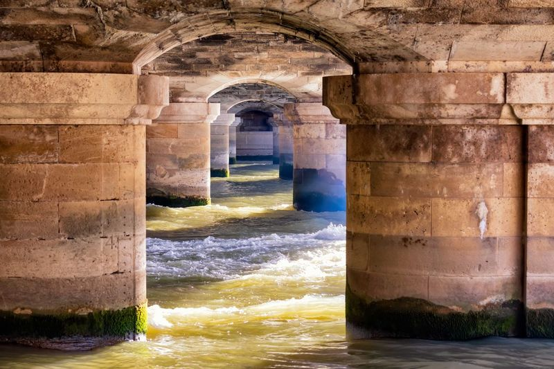 A different perspective History France Paris French Bridge Architecture Built Structure Arch Building Water History The Past No People Old Nature Building Exterior Day Outdoors Wall - Building Feature Wall The Way Forward Direction Corridor Architectural Column Flowing Water