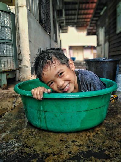 Portrait of smiling boy in bucket
