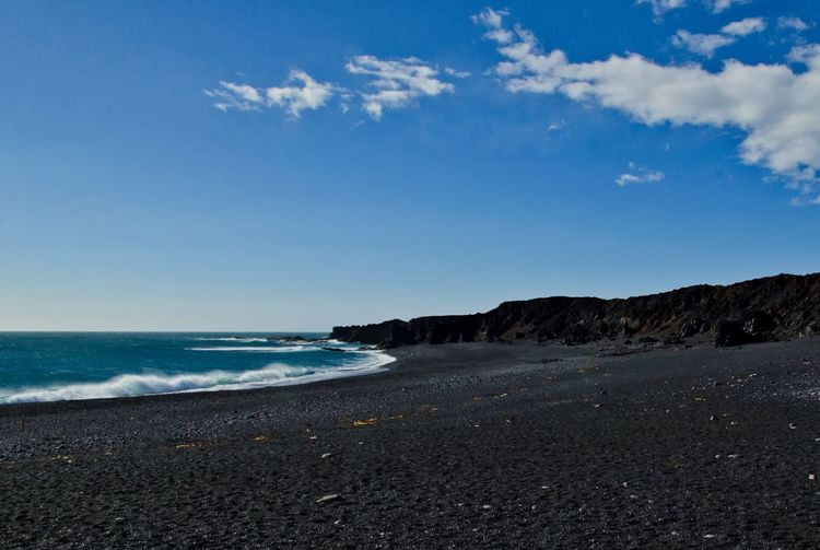 Black sand beach in Western Iceland Black Sand Beach Iceland Black Sand Beach Black Sand Volcanic Sand Beach Sky Beach Water Land Scenics - Nature Beauty In Nature Cloud - Sky Nature Tranquil Scene No People Tranquility Horizon Horizon Over Water Sand Rock Outdoors Day Solid Pebble