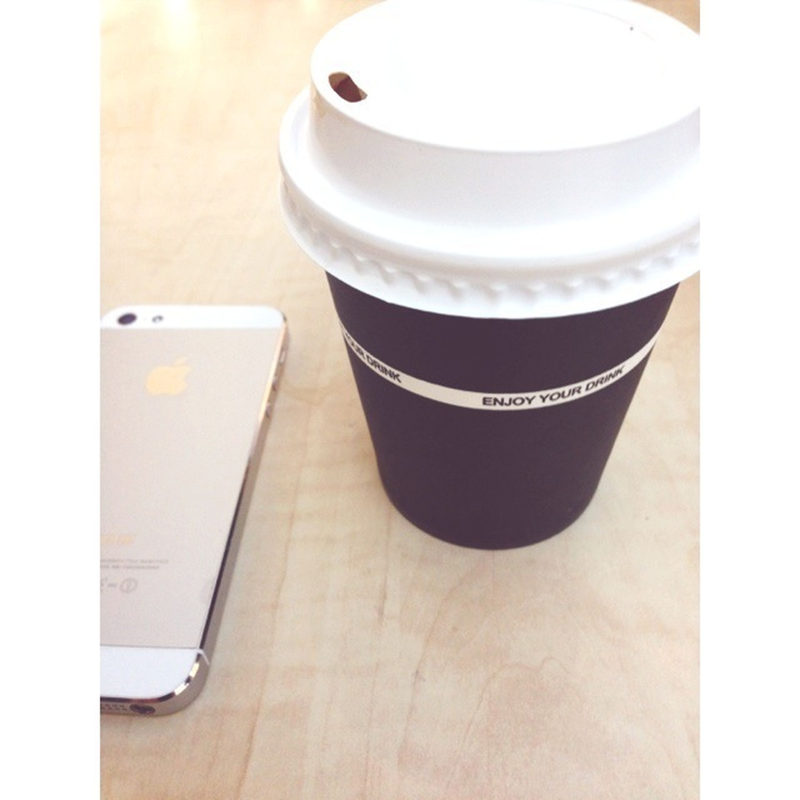 transfer print, indoors, auto post production filter, table, coffee cup, food and drink, drink, still life, close-up, refreshment, cup, high angle view, coffee - drink, coffee, white color, saucer, part of, no people, cropped, freshness