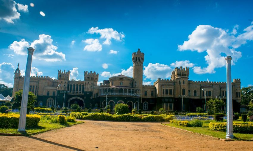 "The Royal Charm of Bangalore. ""Bangalore Palace"" India Bangalore EyeEm Selects Sky Building Exterior Built Structure Architecture Cloud - Sky Building City Day Blue Plant Travel Destinations No People Sunlight Tower Tree Outdoors The Past History Tourism Nature EyeEmNewHere"