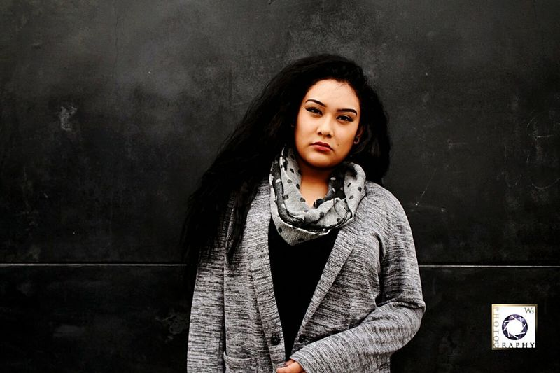 The Portraitist - 2016 EyeEm Awards Black Hair PortraitPhotography Portrait Of A Woman Lifestyle Photography Lancasterca Nikon Portrait Photography Winter Society Portrait Natural Light Grey Sweater Black Wall Outdoors
