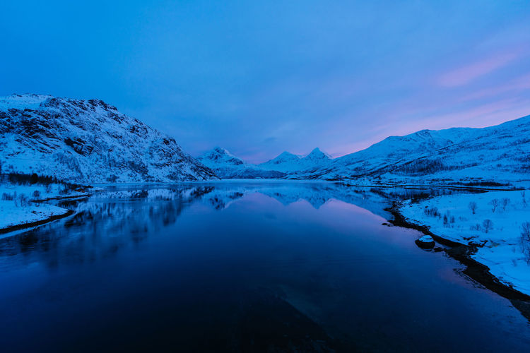 Check out my prints at https://simonmigaj.com/shop/ and visit my IG http://www.instagram.com/simonmigaj for more inspirational photography from around the world. Water Scenics - Nature Tranquil Scene Beauty In Nature Tranquility Mountain Reflection Lake Sky Idyllic No People Cold Temperature Winter Nature Blue Mountain Range Waterfront Non-urban Scene Snowcapped Mountain Reflected  Winter Travel Landscape Morning Dawn