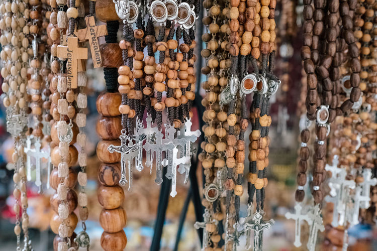 Close-up of rosaries for sale at market